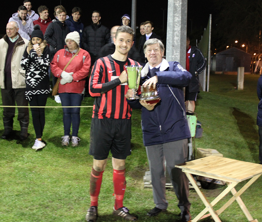 Captain Luke Clark Presented with League Cup Trophy